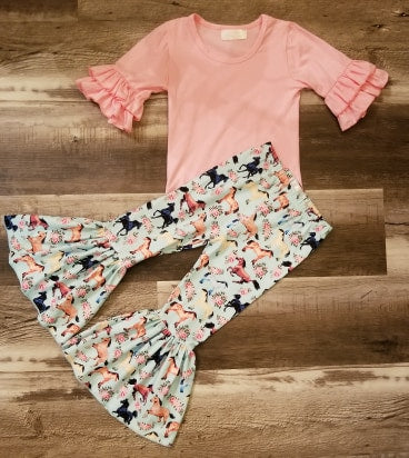Two piece set includes a pink cotton half sleeve top with double ruffles and mint milk silk bell bottom pants with horse print.