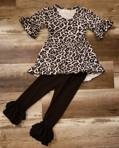 Two piece set features a leopard print high-low top with ruffled half sleeve, and black cotton triple ruffle pants.