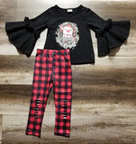 "Black big bell sleeve top with ""Merry & Bright"" and a pig wearing a Santa hat.  Outfit includes buffalo plaid shredders."