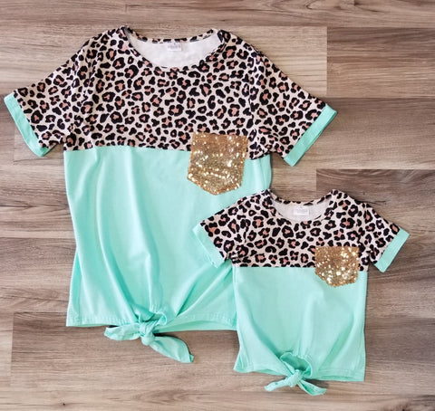 Mint green and leopard print short sleeve top with gold sequin pocket in mom and me sizes.
