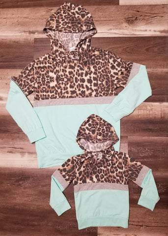 Mom & Me matching mint top with leopard print across front and hood.