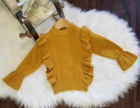 Mustard knit sweater with vertical ruffles on front, and bell sleeves.