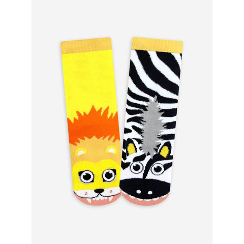 Fun mismatched tube socks featuring a lion on one foot and a zebra on the other.