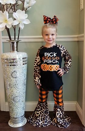 "Toddler set includes black top with ""Pick of the cute patch"" on the front, and leopard print sleeves.  Pants are orange and black checkered with leopard print bell bottoms."