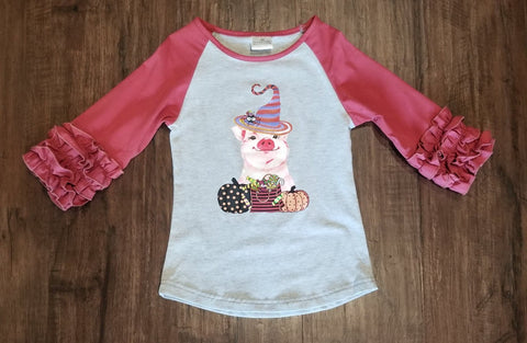 Ruffled sleeve raglan with pig wearing a witch costume on the front.
