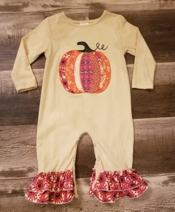 This buttercream romper featrues a multi colored pumpkin on the front, cute ruffles at the ankels and snap closure for easy diaper changing.