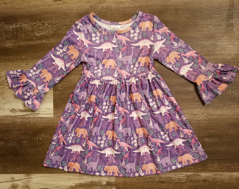 Purple bell sleeve toddler dress with dinosaur print.