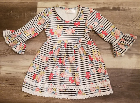 Toddler girls bell sleeve striped floral dress with lace detail along bottom hemline.