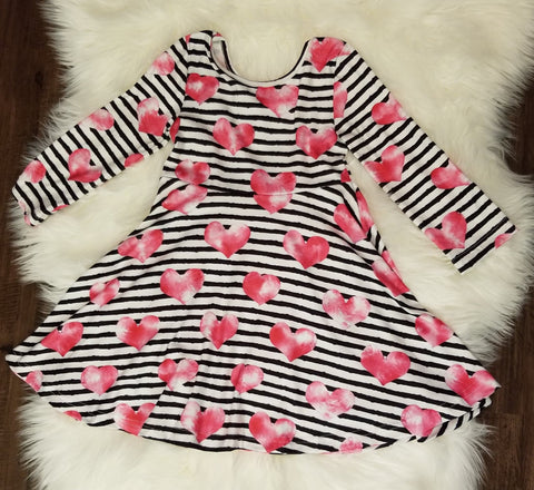 Black and white striped long sleeve twirl dress with watercolor pink hearts.