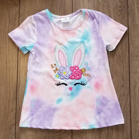 Short sleeve top with bunny ears applique on front, embroidered nose and eyelashes.ed