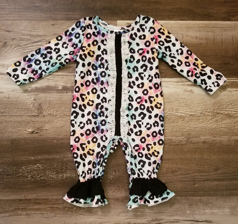 Long sleeve tie dye baby romper with leopard print, lace detail down front and black ruffle at ankle.