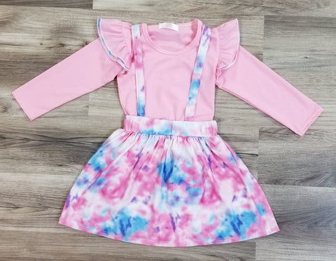 Pink top or onesie with long angel sleeves and a tie dye suspender skirt.  Baby sizes come with onesie, and toddler & girls come with a top.