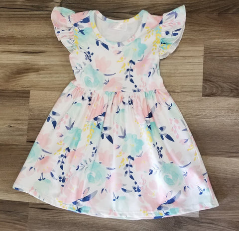Girls flutter sleeve dress with pastel tropical floral print.