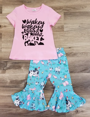 "Pink short sleeve shirt with phrase ""Wakey, Wakey, Eggs and Bakey"" and a pig on the front.  Set includes blue ruffle capri's with farm animals."