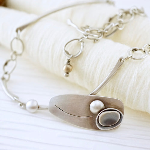 Unique, artisan designed, handmade sterling silver offset necklace | Nesting Bowls collection