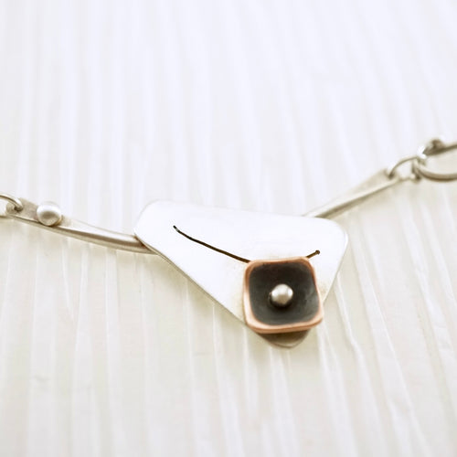 Unique, artisan designed, handmade sterling silver and copper, offset necklace | Square Pods collection