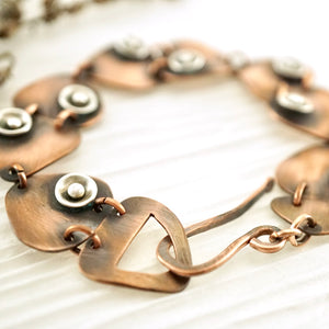 Handcrafted copper dancing triangles link bracelet