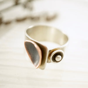 Unique, artisan designed, handmade sterling silver and copper ring | dancing triangles collection