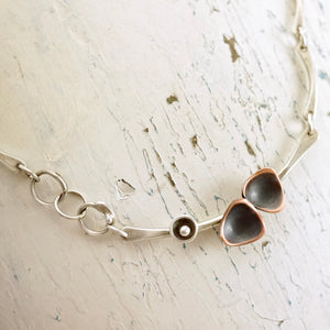 Unique, artisan designed, handmade sterling silver and copper necklace | dancing triangles collection