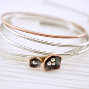 Unique, artisan designed, handmade sterling silver and copper cuff bracelet | Square Pods collection