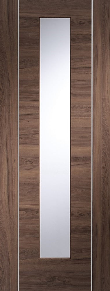 Forli walnut internal door with aluminium inlays and clear glass.