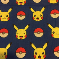 Pikachu and Pokeball Character on Blue Fabric