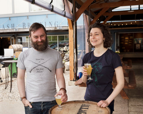 Alex and Emma sport Loyal Citizen Clothing t-shirts in Allagash brewing's tasting room.