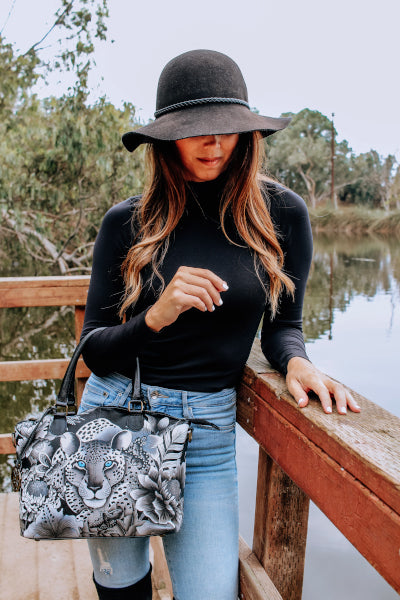 Lady in Hat with Anuschka Bag on Dock