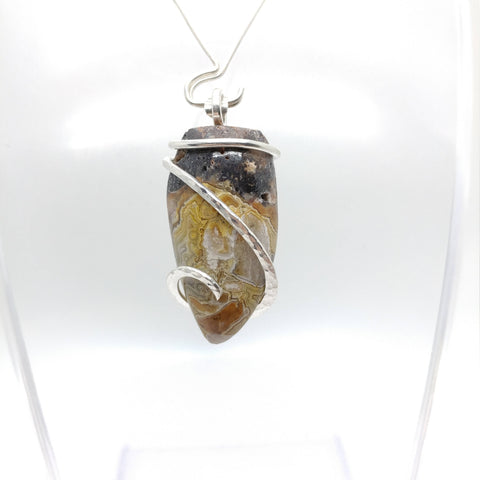 Crazy Lace Agate Tooth Shaped Pendant in Sterling Silver