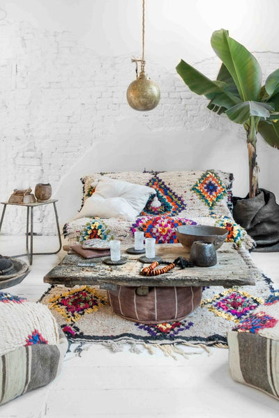 Boho style colorful rug and deco, photo by Paulina Arcklin