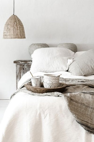 Boho style bedroom lamps next to bed