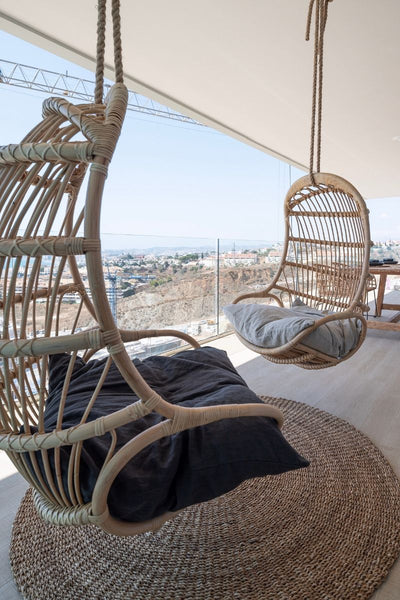 Rattan hanging chair from furniture package in Higueron West