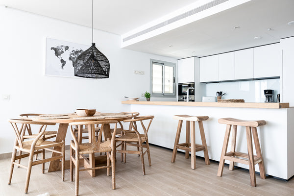 Wishbone chairs together with round table in Higueron West