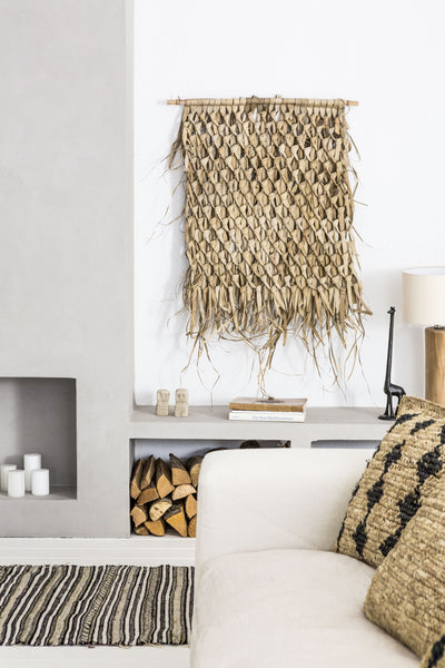 Wall art and textiles to bring texture on your home decor