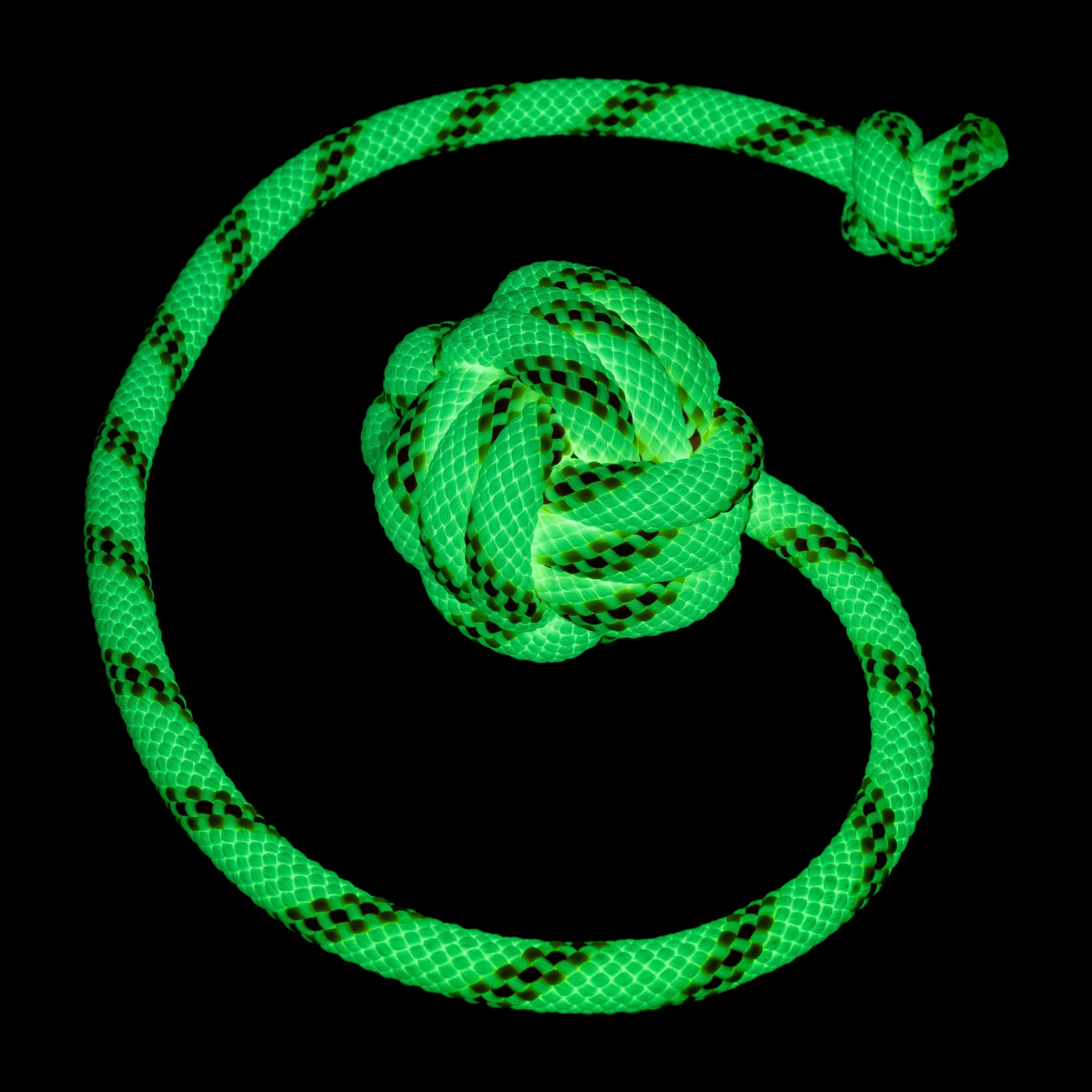 Glow in the dark tied monkey fist dog toy