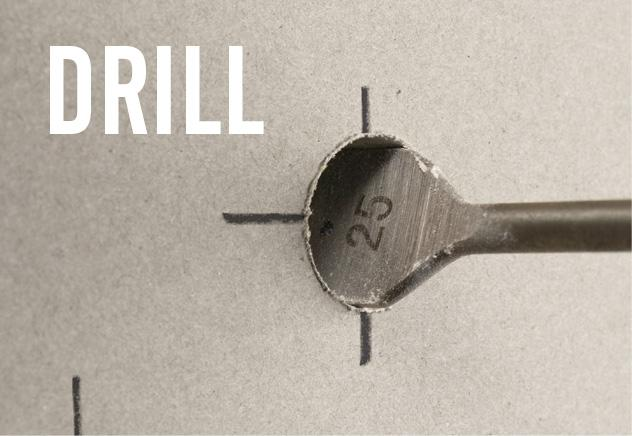 Use a flat drill bit to drill a hole in the drywall.