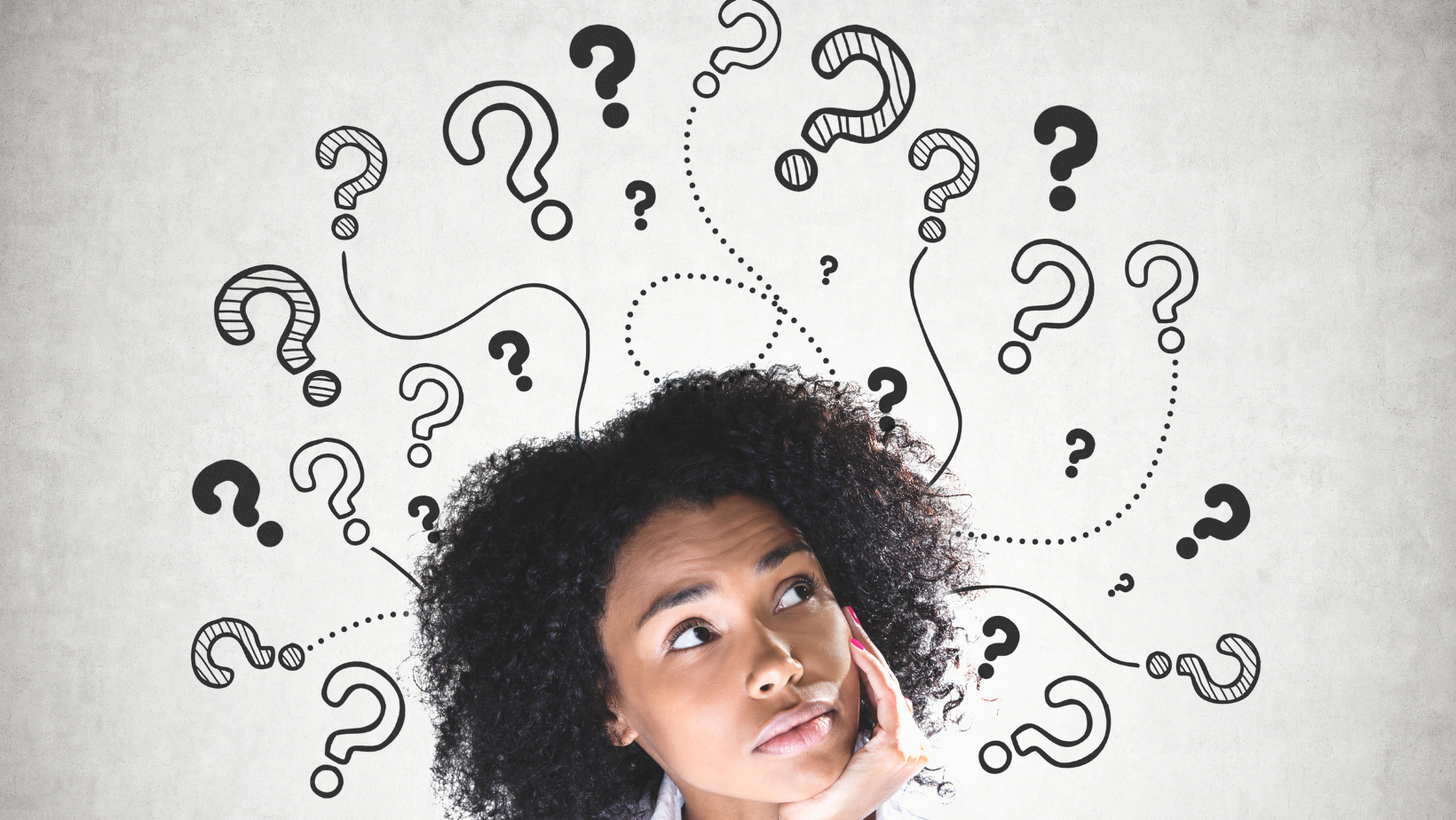 woman with question marks around her head