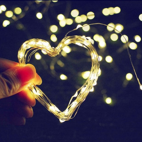 Heart shaped ForverPhotons 200 LEDs 72ft Solar Fairy Lights. Available in warm white and cool white colors. Solar String lights. 8 different modes. Outdoor use.