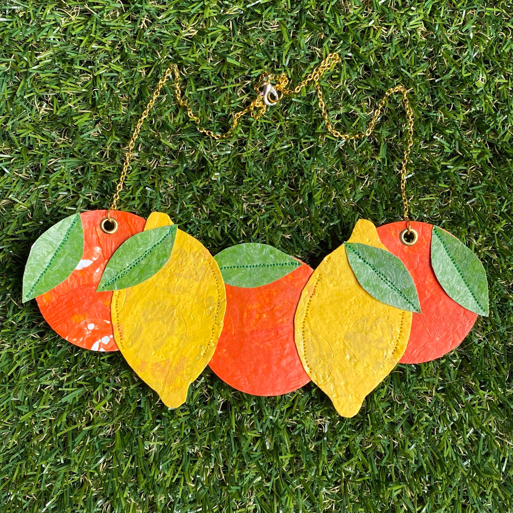 Lemon and orange statement necklace made from recycled plastic carrier bags by Lorelai
