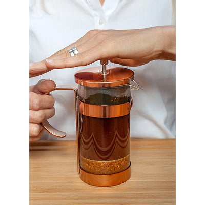 ground rooibos in a french press appliance