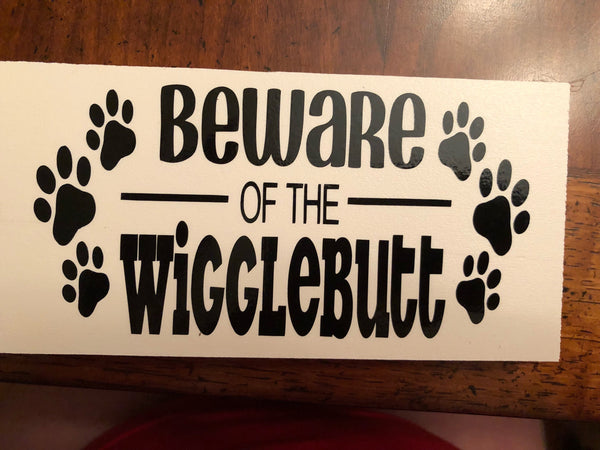 Beware of the Wigglebutts* sign