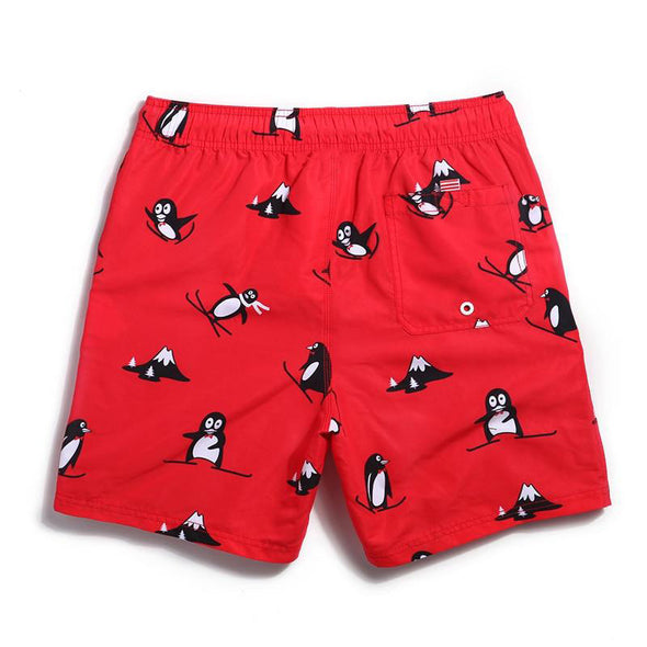 Skiing Penguins Swim Trunks