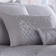 A deluxe combination of glittering sequins on silver satin fabric. This boudoir cushion shimmers and shines, adding pure glamour to any bedroom.