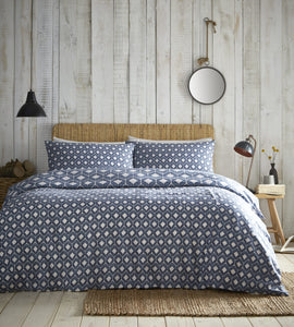a warm and homely ethnic geometric print, inspired by tribal and native shapes and patterns
