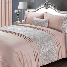 Load image into Gallery viewer, These glitzy Charleston duvet covers have been beautifully made from a blush pink satin fabric featuring a geometric glitter sparkle band across the duvet and down each pillowcase, the perfect addition to any boudoir bedroom. To complete the look, Charleston has a co-ordinating boudoir filled cushion and fully lined curtains.  Product Details  100% Polyester Satin Face Fully machine washable Single sets include one pillowcase Other sized sets include two pillowcases