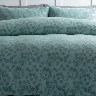 Belledorm Flora is a modern floral jacquard in a warm shade of duck egg green. The beauty of the design is in the simplicity of the pretty scattered petals.