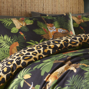 print features tigers, leopards and their companions sitting amongst the jungle trees with a bold leopard print reverse.