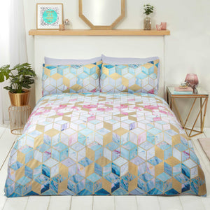 Quartz Rapport bedding. Geometric cubes with turquoise, pink and gold accents