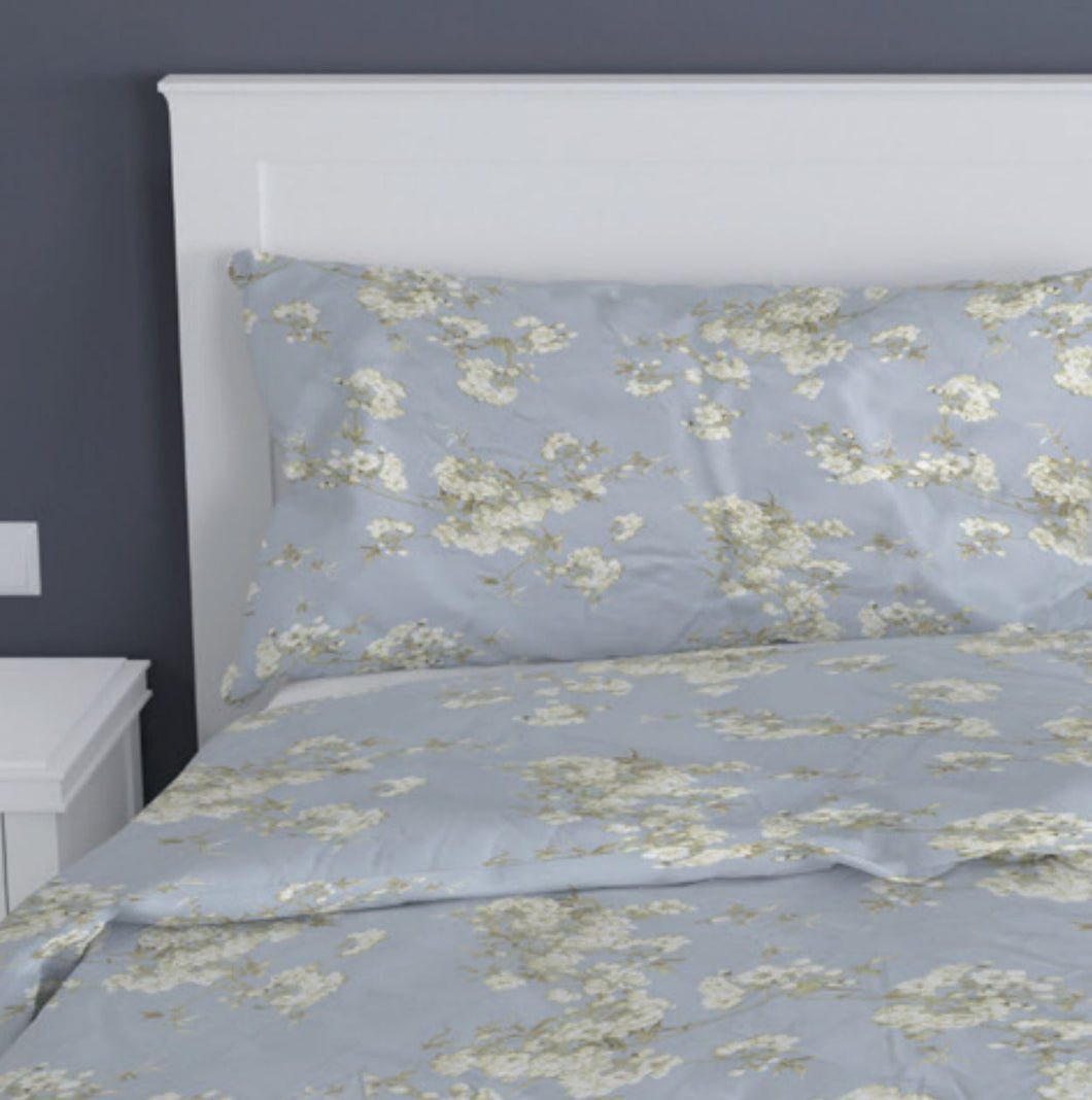 Orchard by belledorm duvet set. Duck egg background with white floral pattern