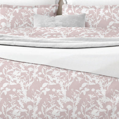 Rosie by Belledorm An all over shadow print of leaves, flowers and butterflies printed in soft tones of Whie & Pink.